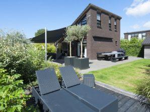 Luxus Ferienhaus mit sonnigen Garten