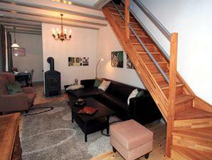 Ferienhaus Gartenhaus im Einhornhaus mit Kamin und privater Terasse