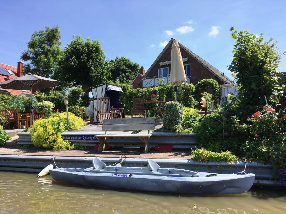 Ankerhaus am Siel mit Terrassen und Bootsanleger