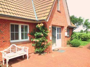 Ferienwohnung im Ferienhaus Friesenglück (EG)