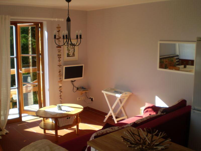 Ferienhaus Romantisches Holzhaus mit Ruderboot