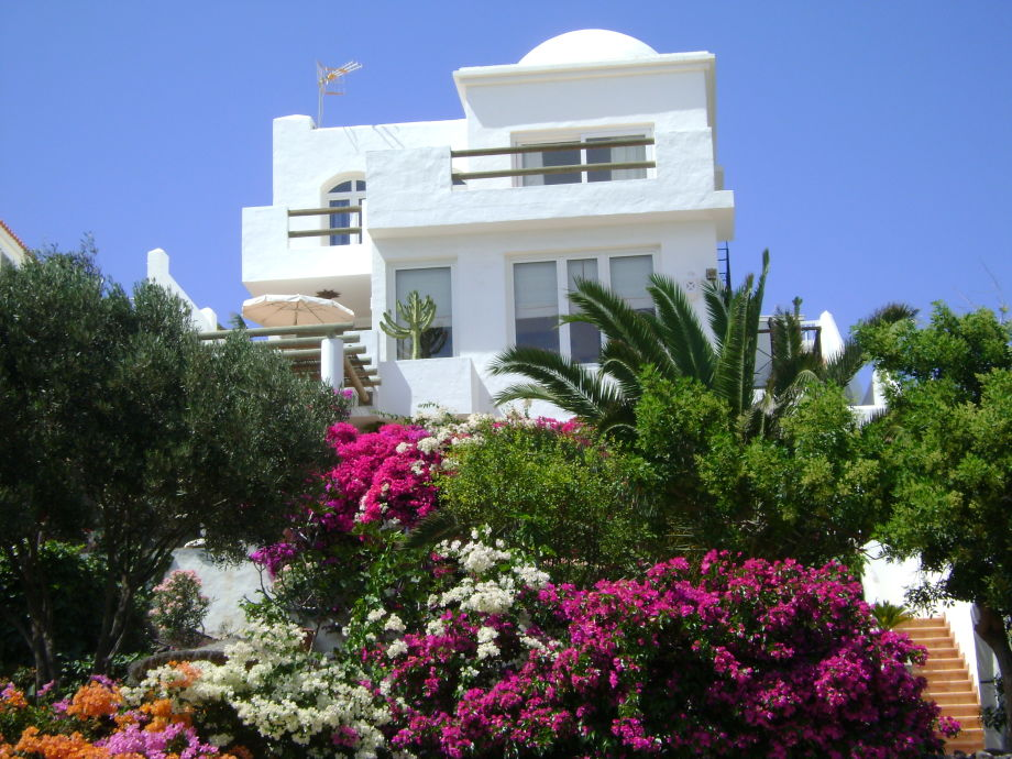The penthouse holiday home is at the top left of the house
