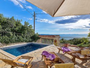 Holiday house Charming sea view holiday home in Podgora