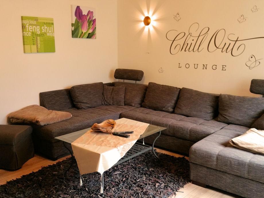 Wohnbereich mit Relaxzone und Bettfunktion