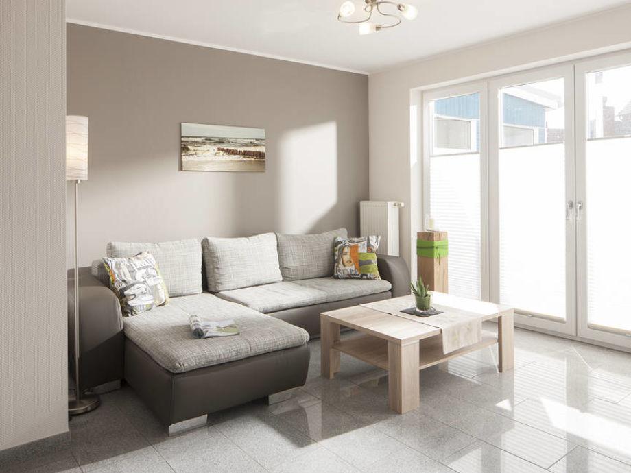 Das helle Wohnzimmer mit Sitzecke