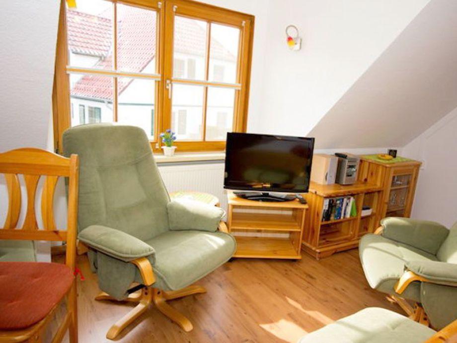 Der gemütliche Wohnbereich mit Fernseher