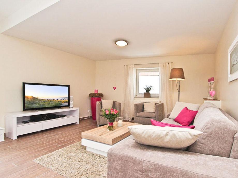 Couchgarnitur mit Flatscreen- TV