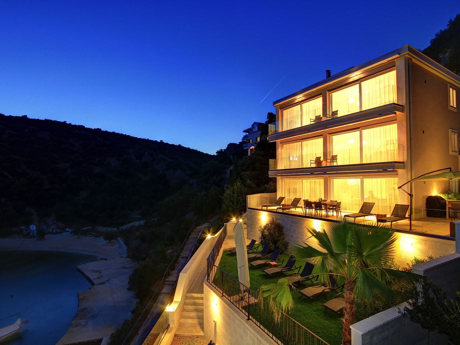 Villa by the sea at night
