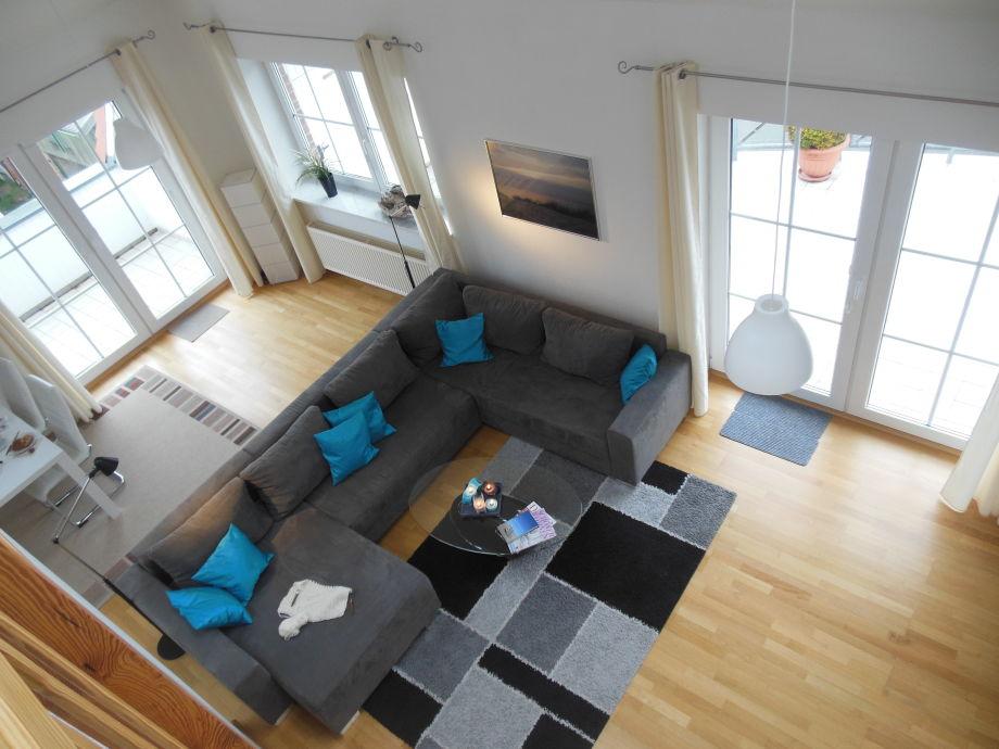 Wohnzimmer mit angrenzendem Essbereich