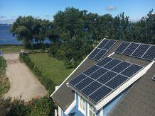 Ferienwohnung 4 im Strandhaus-Wiek mit Terrasse zum Wasser