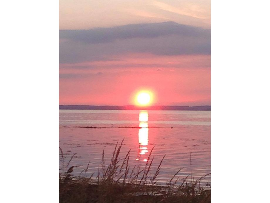 Sonnenuntergang vom Hausstrand aus zu sehen