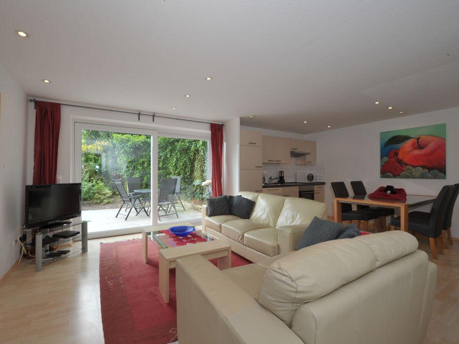 Livingroom-Kitchen, large sliding window to the Garden