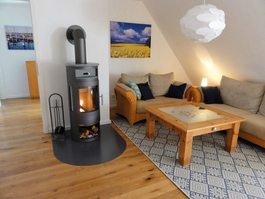 Cozy sofas by the fireplace