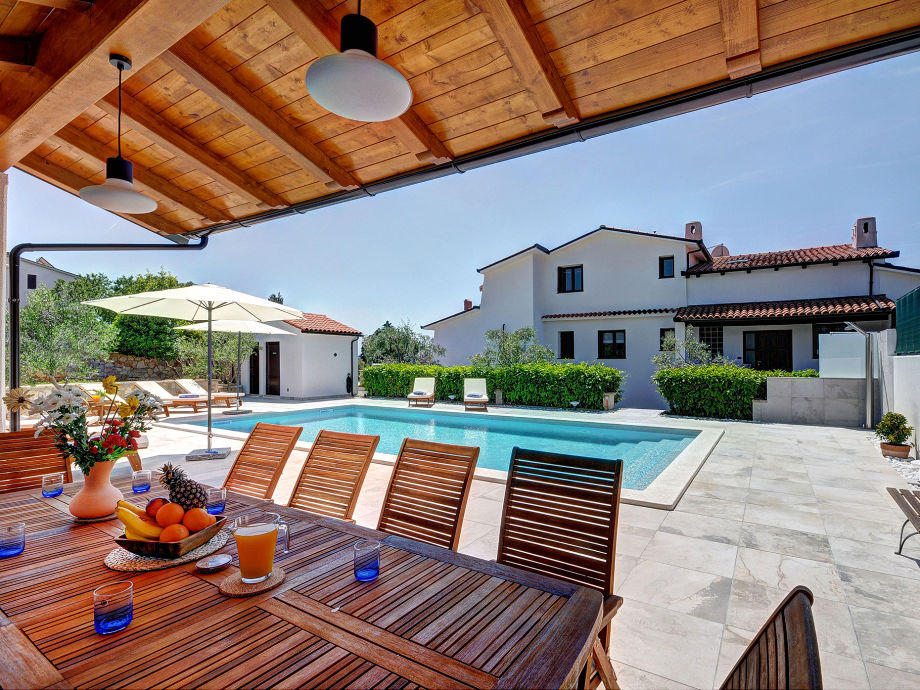 Summer terrace overlooking the pool