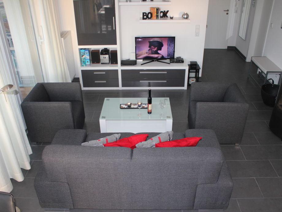 Im gemütlichen Wohnzimmer schöne Spiele-...