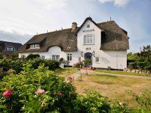 Ferienwohnung Witthüs 18 - stilvoll Wohnen unter Reet