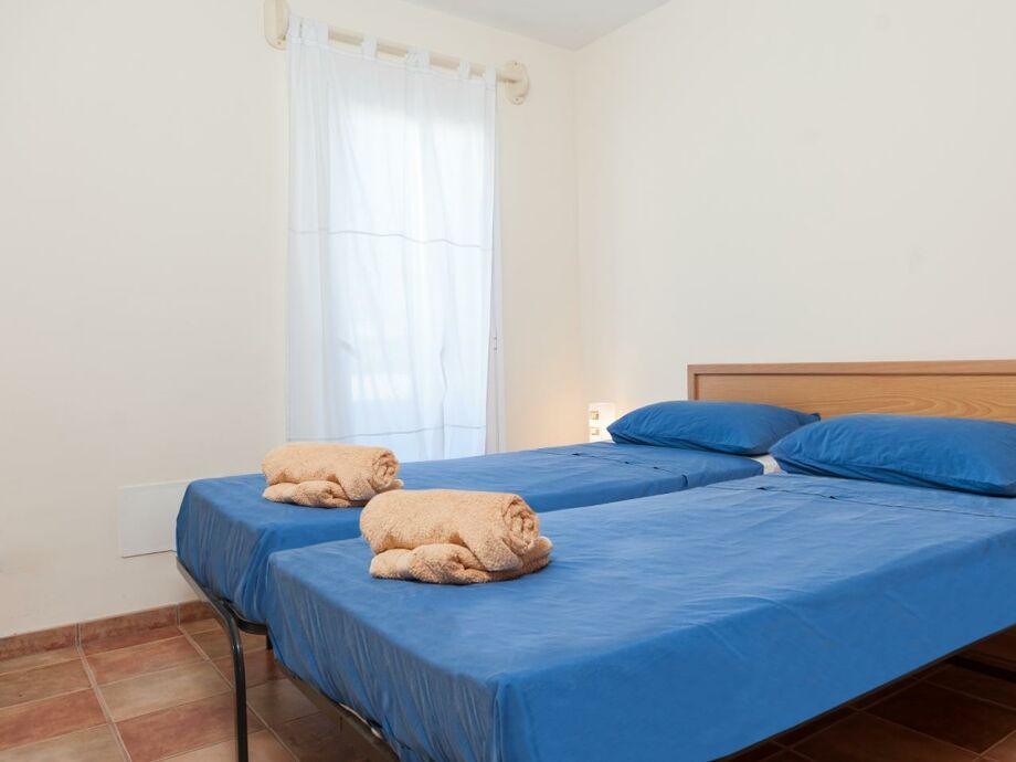 Weiteres Schlafzimmer mit Doppelbett