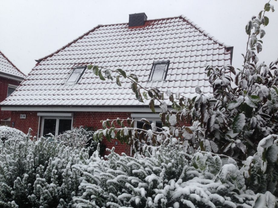 front of the house in the winter wonderland of Hamburg