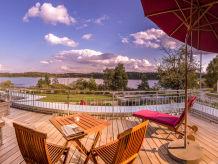 Ferienwohnung See Lodge im Ferienhaus Lebensart am See