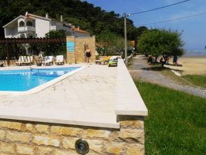 Ferienwohnung Mel - Sandstrand & Pool