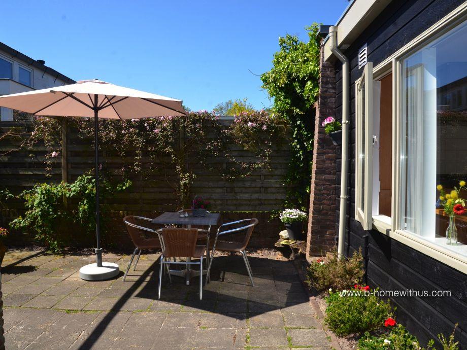 Ferienhaus Het Tuinhuis mit sonniger Terrasse