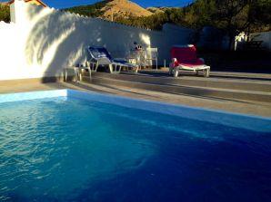 Ferienwohnung Alma mit Pool