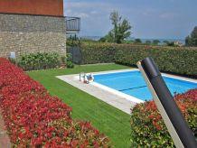 Ferienwohnung Rolly-Apartement mit Pool am Seeufer