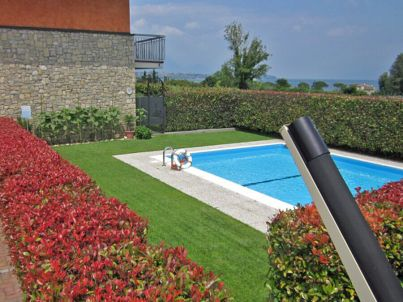 Rolly-Apartement mit Pool am Seeufer