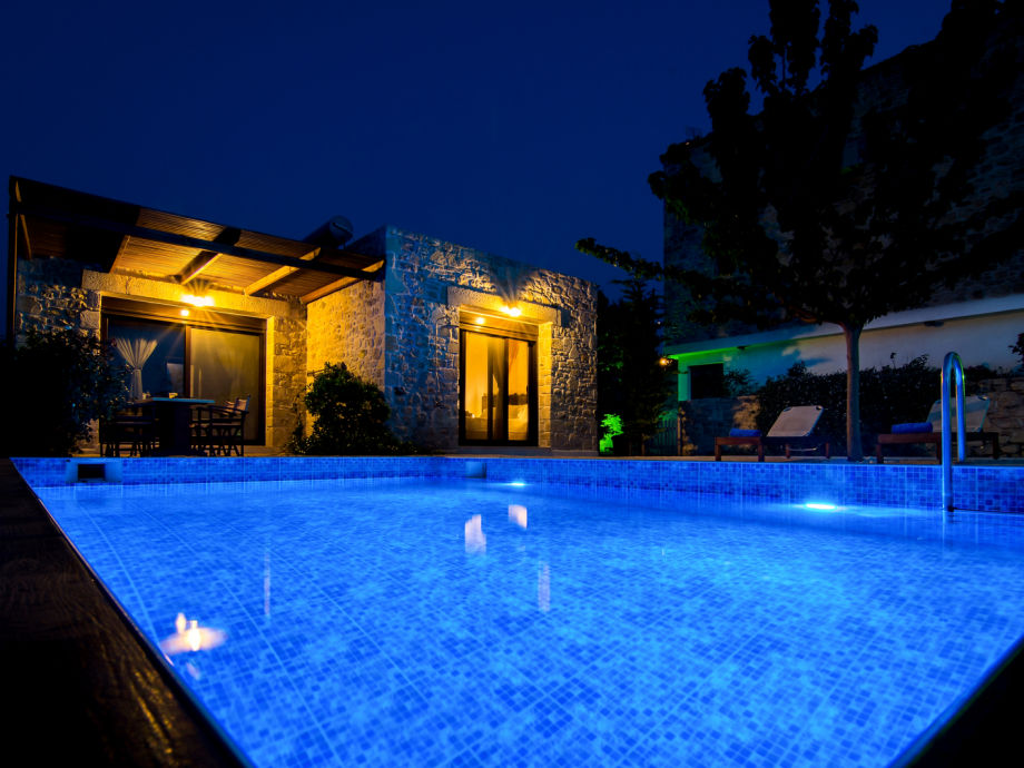 the private pool of the villa during night