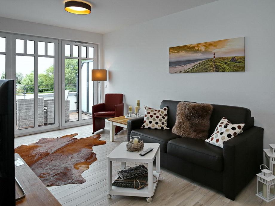 Wohnbereich mit Flachbild-TV und Doppelschlafcouch