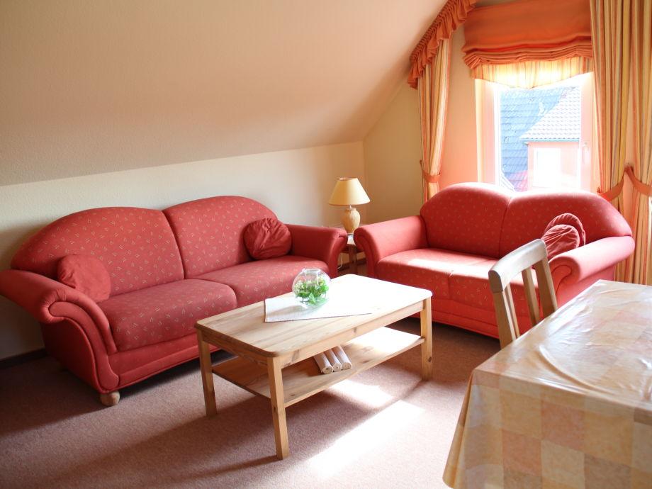 Wohnbereich mit Couch Garnitur