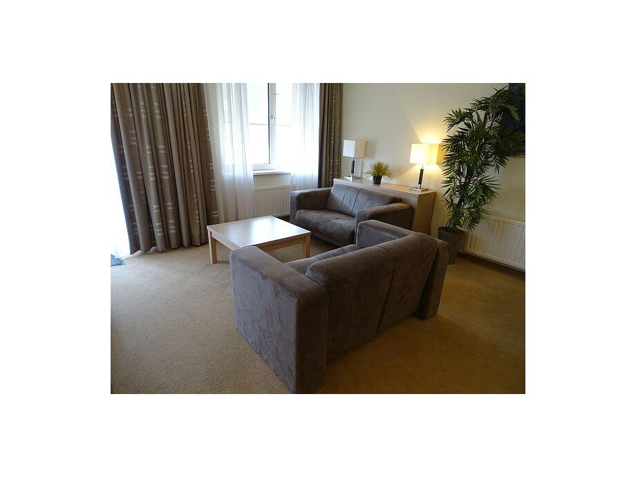 Das schöne Wohnzimmer mit einer Sitzecke