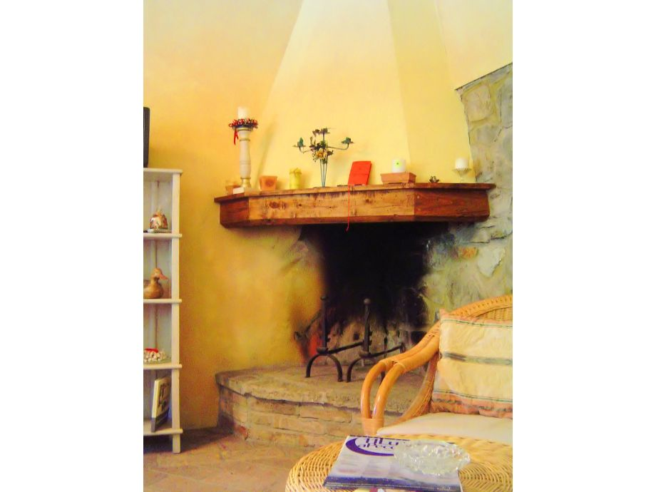 Wohnzimmer Mit Kamin Und Kochnische