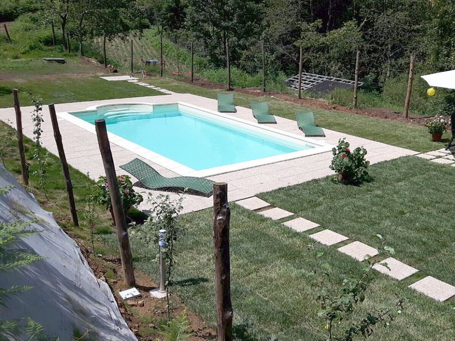 Swimming pool in fenced garden