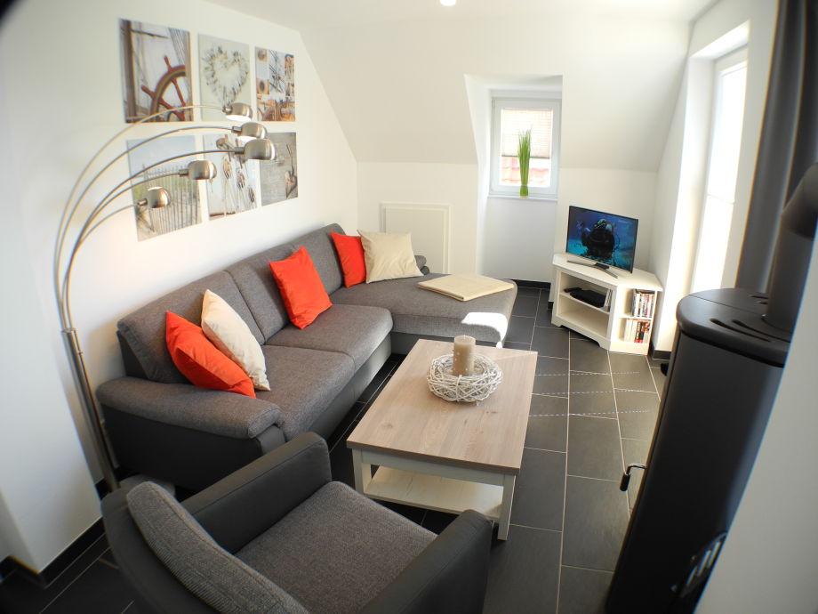 Entspannen Sie im luxuriösen Wohnbereich mit Kamin