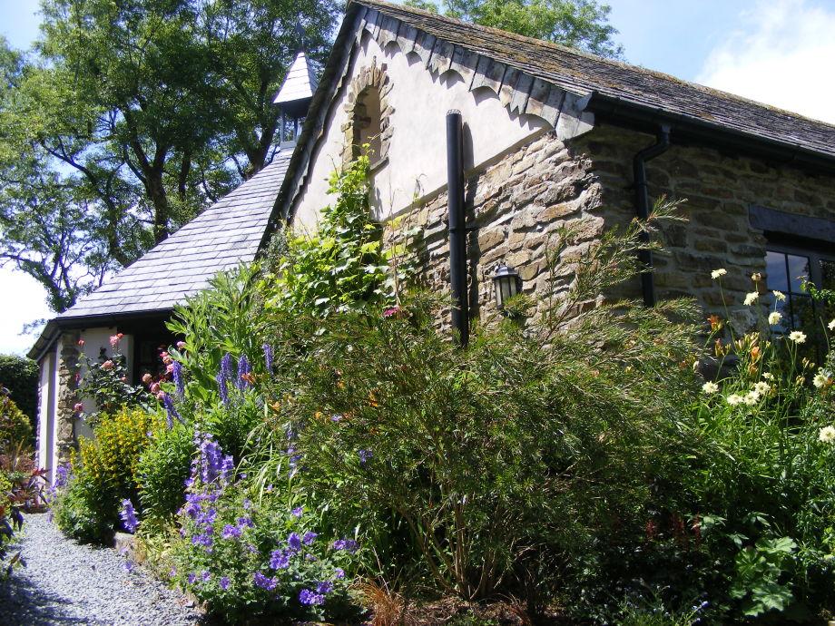 Roundhouse cottage garden entrance in June