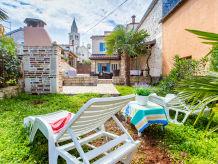 Ferienhaus Ferienhaus Maris mit Garten