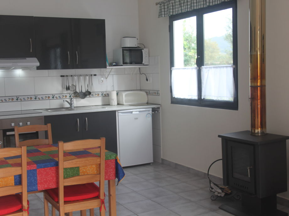 Kitchen with dining area and charcoal oven