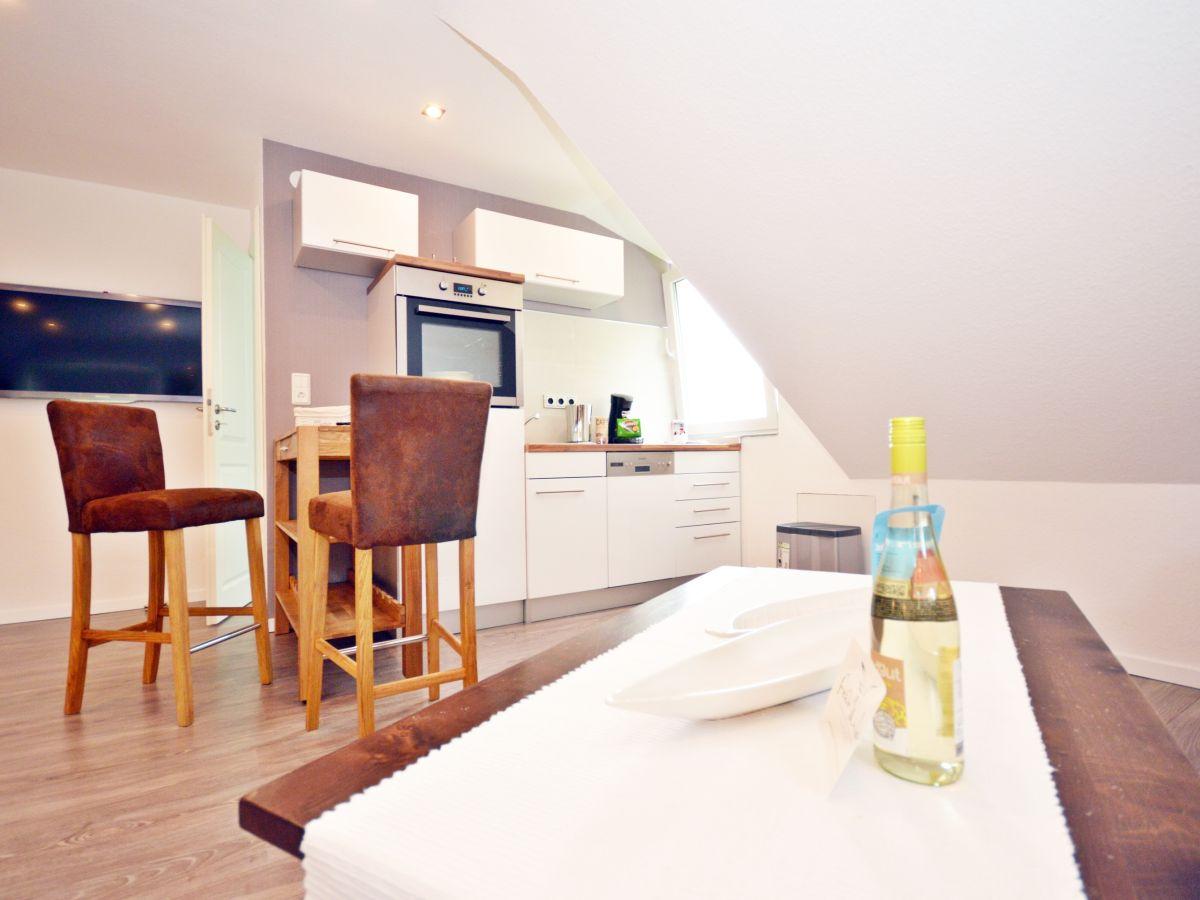 Apartment apartement uttied norden firma for Fertige kuchenzeile