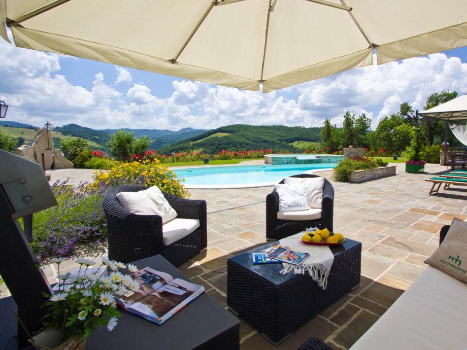 Apartment Estate - pool side sofas