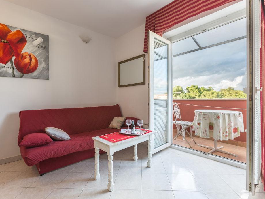 Wohnraum und Terrasse mit Meerblick