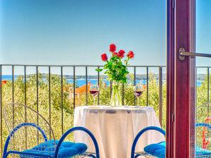 Ferienwohnung mit Meerblick und Terrasse