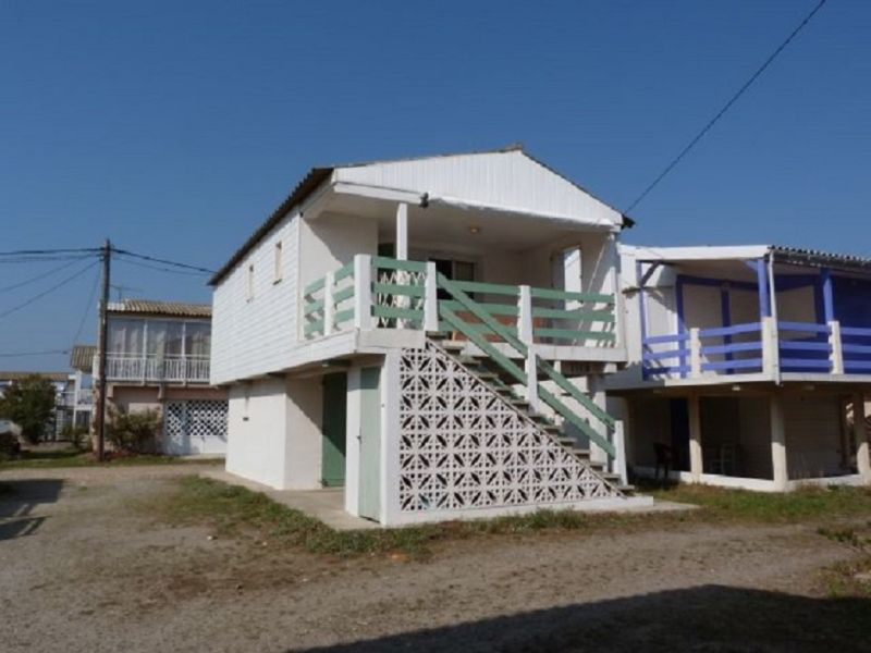 Holiday cottage on piles near the beach