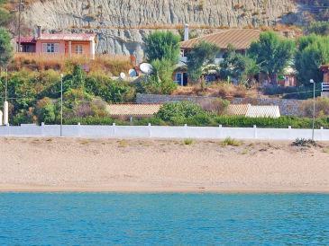 Ferienhaus Einzigartiger Meerblick in direkter Strandlage