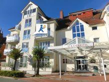 Ferienwohnung Strandhotel 21