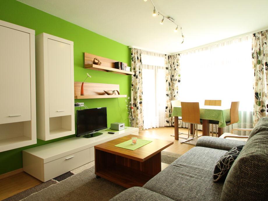 Living room with balcony, TV, games and sleeping sofa