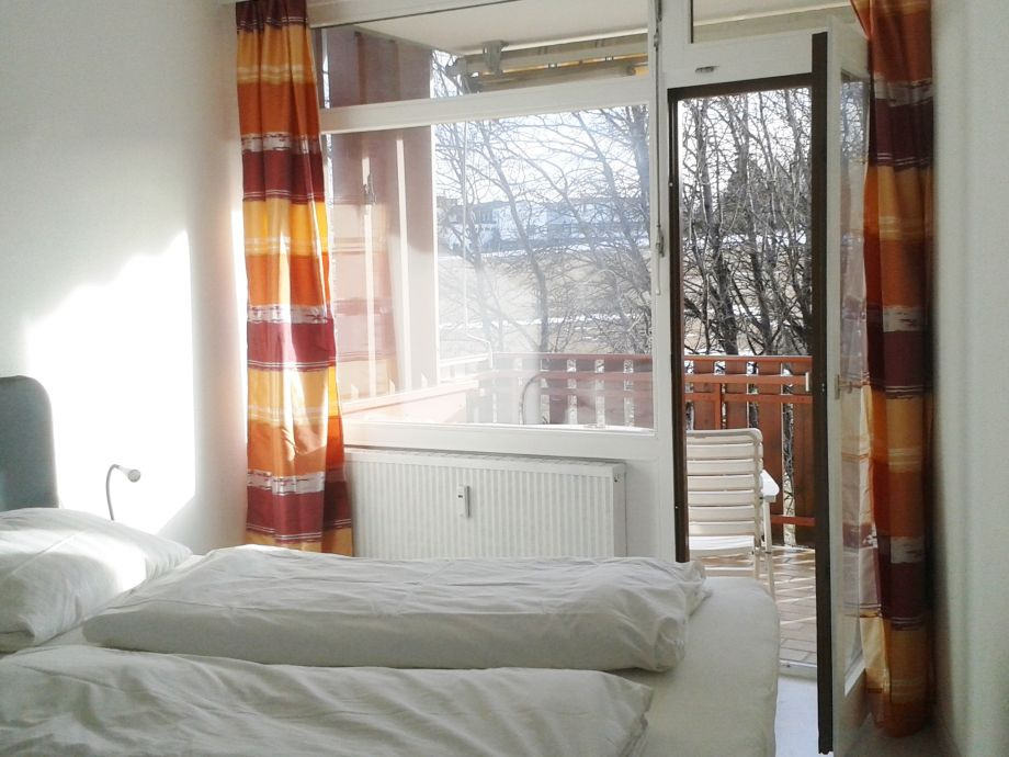 Bedroom with balcony and view of the Black Forest