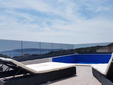 Ferienhaus mit Pool auf dem Dach