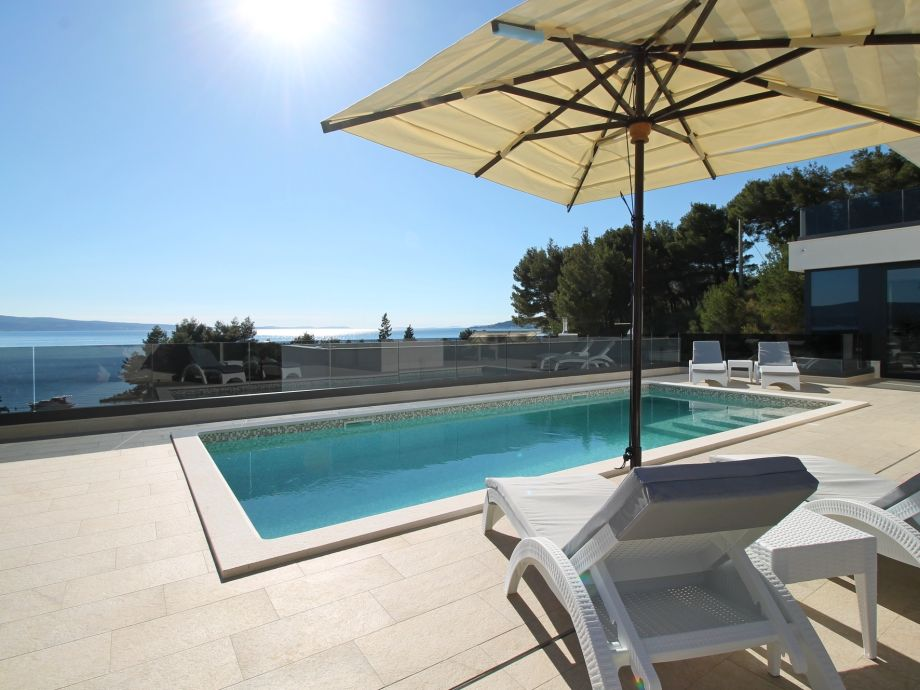 Sun deck area with heated pool, opened sea views