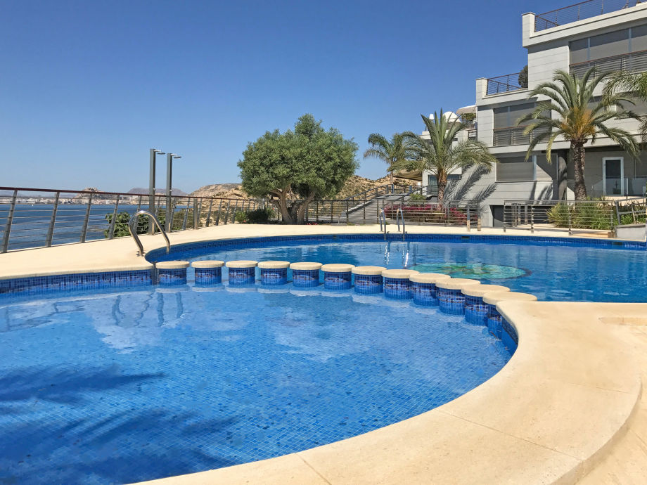 Communal swimming pool with stunning sea view